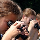 VBS students focus binoculars on a bird!